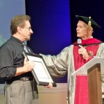 Dr. Ken Brewer, founder and president of The Kaleo Institute awards Pastor Fred with honorary doctor of divinity degree